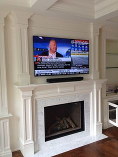 """SONOS Playbar with 65"""" Samsung TV above fireplace"""