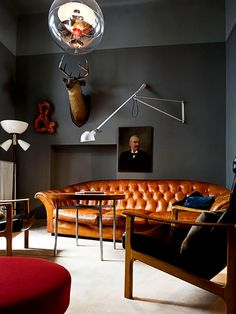 It's no secret, I do like black and brown together. I like vintage and modern together. It just works for me. Cool couch. Good paint. Good chair. Good lamp. etc.