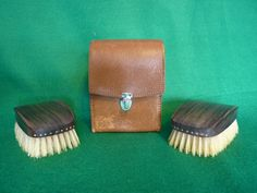 1950's Gentleman's Clothes Brush Set. Pigskin leather case and pure bristle brushes. To be used before leaving the house to eliminate pet hairs, dust and soot specks from the open fire. 7cm x 12cm x 9cm.  Price includes UK postage, please e-mail for international postage details.  £7.49
