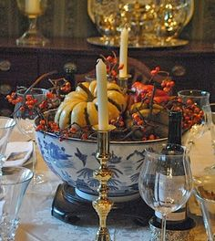 Habitually Chic®'s centerpiece photo based on the traditional look of a blue & white bowl and a pair of brass candlesticks + pumpkins and gourds. This is a table design which will appeal to guests and family members, alike!