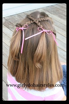 Criss-Cross Braid Pigtails ~ This is a very easy style. I actually saw a cute little girl wearing this style the other day and wanted to share...Braids and ribbon are what's in style right now...