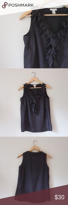 Silk Sleeveless Blouse with Fringe Beautiful black sleeveless blouse, 100% silk, with fringe detail around neckline. In excellent gently used condition. J. Crew Tops