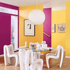 Contrasting paint colors are the perfect complement to white dining furniture.