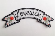 • L O V E S I C K • The Lovesick Banner is a carefully hand embroidered patch with tiny detail stitching with rosebuds decorating at ends. Perfect back