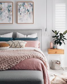 I would reverse and have a blue comforter and blush accent pillows