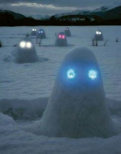 Glowing Snow Ghosts ~ pile snow into mounds & insert glow sticks or led lights for the eyes ~ halloween spooky fun all winter long ~ snow play fun for the kids ~ outside winter fun ideas