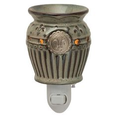 Charlemagne  Plug In scentsy warmer.... Like this purchase today and like my facebook fan page:    https://www.facebook.com/media/set/?set=a.10150364570080344.604384.555635343&type=3#!/pages/Ashley-Nichols-Independent-Scentsy-Consultant/297557330292599