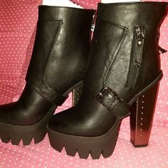 Moto Style Platform Boots *NWB* Black moto style platform boots with silvertone metal finished heel. Back zipper closure. Buckle detail. 4 inch heel with 1 inch platform in front. Never been worn. Style: Vanita02 original box. Bumper Shoes Combat & Moto Boots