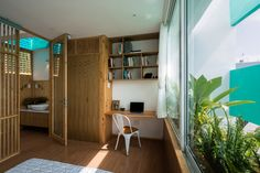 HA's vietnamese 'less house' combines compact urban living with the serenity of nature