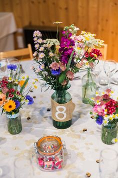 Flowers Centrepiece Bottles Hessian Table Number Relaxed Budget Friendly Village Hall Wedding http://www.lisadawn.co.uk/