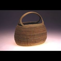 Tall Oval Market Basket Description: Hand coiled seagrasses.    Dimensions: H:13.00 x W:11.00 x D:13.00 Inches