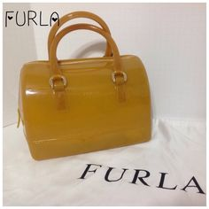 FURLA Girasole Candy Bag 100% PVC.  Colour: Girasole 012.  777405 B Base8 PL0 Candy.  This one is the one with the noticeable dirt on the dust bag.  What you see in the pictures is what you get.  These purses are great, but avoiding scratches is not great.  Minor scratches, but do not take away from it's beauty.  Happy Poshing! Temp Sale Furla Bags Mini Bags