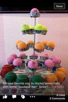 Cute idea to display tennis balls in pet shop