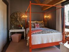 HGTV Dream House, Lake Tahoe: Guest Bedroom Interior designer Linda Woodrum took advantage of the high ceilings by making the centerpiece of this room a red-orange four-poster bed. Using a desk in place of a traditional nightstand allows this room to double as an office.