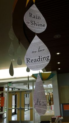 rain or shine we love reading all the time - good library display inspiration (umbrella? Bulletin board?)
