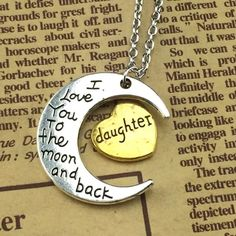 """Daughter Necklacr Moon and heart alloy necklace that says """"daughter"""" on the gold toned heart and """"I love you to the moon and back"""" on the silver toned moon. Jewelry Necklaces"""
