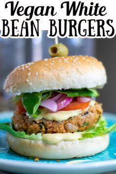 These Vegan White Bean Burgers are so healthy and delicious! A combination of cannellini beans, oats, pureed tomatoes, herbs and spices blended together for the perfect plant-based meal. Learn how to Make Vegan White Bean Burgers in less than 30 minutes! Vegan Lunches, Vegan Foods, Vegan Snacks, Vegan Dinners, Vegan Bean Burger, Black Bean Veggie Burger, Vegan Burgers, White Bean Recipes, Plant Based Burgers
