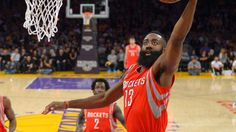Houston Rockets guard James Harden, right, goes up for a shot as Los Angeles Lakers guard Jordan Clarkson defends during the first half of an NBA basketball game, Sunday, Jan. 25, 2015, in Los Angeles.  (AP Photo/Mark J. Terrill)
