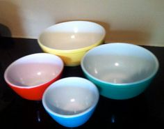 1950s Pyrex yellow/green/red/blue Nesting 4 piece bowl set