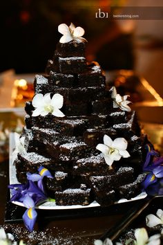 Brownie pyramid instead of a cake! Nick likes this for the grooms cake. Of course, I wouldn't use flowers to decorate it. I have a pretty cute idea instead of flowers Brownie Wedding Cakes, Brownie Cake, Wedding Desserts, Cake Brownies, Pretty Cakes, Beautiful Cakes, Grooms Cake Tables, Fondant, Wedding Cake Alternatives