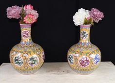 Pair Chinese Ming Dragon Vases Urns Famille Rose  - Gorgeous pair of Chinese Ming style porcelain vases of Shangping - or bulbous - form - I love the famille rose colour scheme with yellows, pinks and blues, very eye catching - Hand painted designs are amazing including dragon panels and intricate arabesques on every surface - The gorgeous hand carved bone Chinese console table is available but not included in this listing -