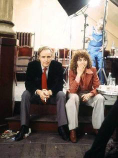 Marlon Brando and Maria Schneider having a smoke break on the set of Last Tango In Paris (1972).