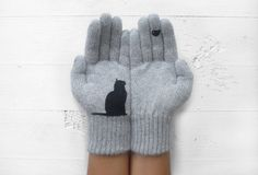 Nice idea to copy.  -  These adorable gloves feature a black cat silhouette peering up at a little bird. Soft lambswool blend with felt decorations. Handmade in Istanbul. $36 from the Talking Gloves Etsy shop.      (01.15.15)