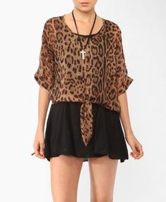 I can't get enough of animal print. I would wear this with skinny jeans, shorts and peep toe shoes.