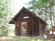 A small cabin in the Upper Peninsula of Michigan.  I wonder how they treated the wood.  It looks like creosote or thinned tar.  Does any one know?