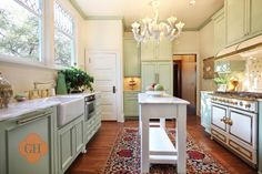 i like the oriental rug in the kitchen; also the mint green