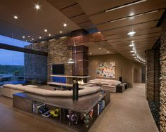 Interesting use of lines with different materials. Like the rock work and large wooden beam to break up the space. Of course, love the floor to ceiling windows.