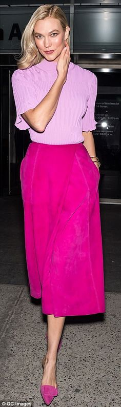 Tall drink of water: Standing at a towering 6foot2, Karlie opted for buckled pink flats wh...