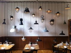 Old vintage hanging lamps at The Corner Room in Bethnal Green, London.