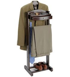 Organize clothing and personal accessories for tomorrow morning with this Executive Dark Walnut Wood Men's Personal Valet. This clothing valet includes a hanger for jackets and shirts a slacks hanger and a large drawer that is great for storing wallets watches cell phones and other personal accessories.Dark