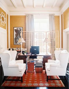 White black gold chinoiserie office design with black & gold Asian folding screen, caramel sawhorse desk, glass column lamp and slipcovered chair. Description from decorpad.com. I searched for this on bing.com/images