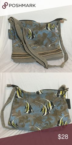 """Guy Harvey fish purse Guy Harvey fish purse - 13"""" wide, 12"""" tall, and 3.5"""" deep. Strap adjustable to 51"""". Some wear on interior but otherwise in great condition. Guy Harvey Bags Crossbody Bags"""