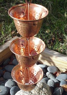 The Copper Bells Rain Chain - would love to put this right outside my kitchen window.