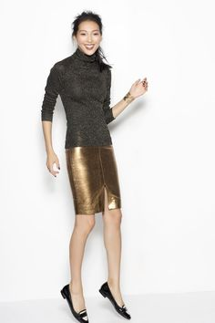 Gold faux leather pencil skirt with small slit up the center front.  Great pairing with the black sweater with metallic flake.  Perfect outfit for the office Christmas party!