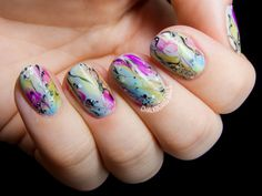 Watercolor marbled nails by @chalkboardnails