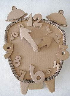 Cardboard Clock DIY Make a Cardboard Clock and let your children decorate diy ideas with cardboardEnjoy this list of creative cardboard crafts, and make your own creation. Do not worry about whether you are wasting anything, because cardboard c Cardboard Sculpture, Cardboard Toys, Cardboard Furniture, Diy Crafts Cardboard, 3d Paper Crafts, Kids Crafts, Diy And Crafts, Arts And Crafts, Decor Crafts