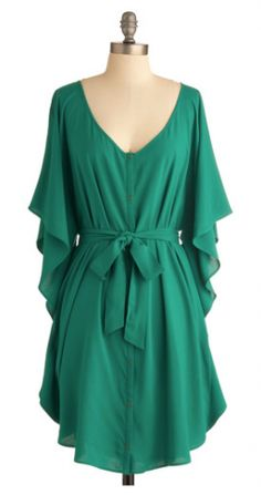 Fun emerald dress with tie and flowing sleeves.  https://www.thebridelink.com/vendor/mod-cloth/photos #dresses #emerald