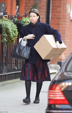 16. Lady Sarah Chatto carried a large package along the streets of ...