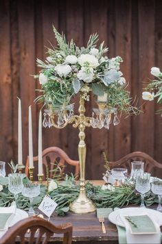 Cozy Winter Wedding Styled Shoot - Looking for winter wedding inspiration? Check out this styled shoot full of pretty details: winter whites, lush greenery, champagne toasts, and a hint of sparkle. gold and green candelabra centerpiece Christmas {Conforti Photography LLC}