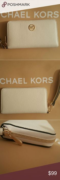 NWT* Michael Kors Fulton Wallet/Wristlet * NWT* Michael Kors Fulton Wallet/Wristlet* Color: Ivory * Holds Cell Phones * Gorgeous * Feel free to Inquire and ask Questions * Reasonable offers accepted * Bundle & Save * Michael Kors Bags