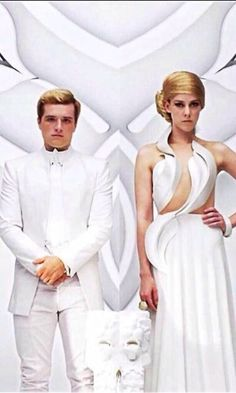 PEETA AND JOHANNA THEY LOOK PISSED OFF. AND JOHANNA'S HAIR IS GONE, REPLACED BY A WIG, AND PEETA'S CHEEK IS RED noooooo