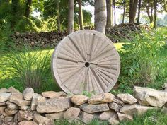 Millstone/Grindstone Hypertufa DIY - I've seen them for sale on various websites and boy are they espensive! I plan on making some with hypertufa to create a fountain which will save me a lot of money. Just make a circle with aluminum flashing on plywood and line it with plastic wrap, then fill with hypertufa. WA LA! Cheapo millstone in any size you want.