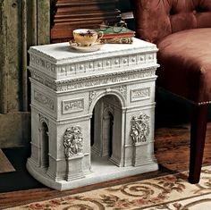 Arc de Triomphe Sculptural Table. Goes with the Eiffel Tower one.   I die.