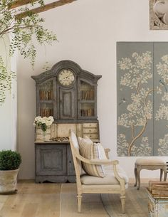 Modern farmhouse living room with Swedish antiques, European inspired furniture, French oak floors, Gracie wallcovering, and vines. Patina Farm. Giannetti Home
