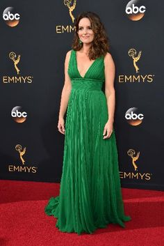 Tina Fey stunned on the red carpet in a green Oscar de la Renta gown at the 68th Annual Primetime Emmy Awards.