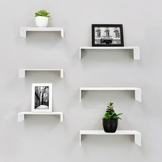 Create a unique accent wall design with this Kiera Grace wall shelf set. Large Shelves, Display Shelves, Shelving, Woodland Theme Bedroom, Accent Wall Designs, Floating Wall Shelves, Decorating Small Spaces, Cool Walls, Storage Spaces